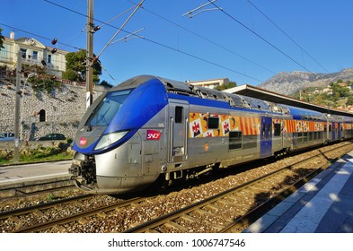 MENTON, FRANCE -21 DEC 2017- View of a Train Express Regional (TER) at the Gare de Menton, a railway station located in Menton, Alpes-Maritimes. The trains are operated by SNCF.