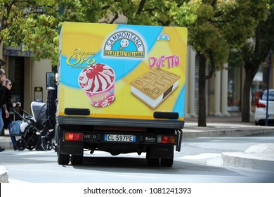 Menton, France - April 5, 2018: Italian Ice Cream Truck (Iveco Daily) Driving on The Road in The City Center Of Menton On The French Riviera