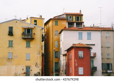 MENTON, FRANCE - CIRCA JULY 2014: Facades of a old buildings with bright painted walls in Menton (France)