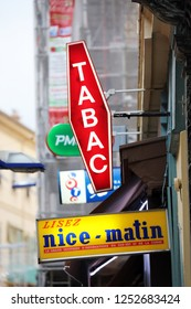 Menton, France - December 7, 2018: French Tobacco Shop, Nice-Matin (Regional Daily French newspaper), LOTO And PMU Signs On A Street Corner