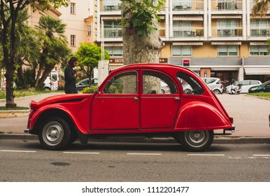 MENTON, FRANCE - JUNE 6, 2018: Old vintage cars Citroen 2CV on the street of city