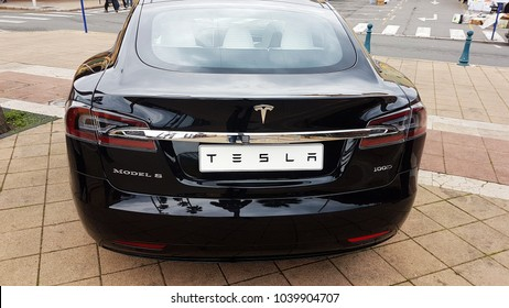 Menton, France - March 3, 2018: Black Tesla Model S (Rear View) Electric Car Parked on a Square in Menton on The French Riviera. The Tesla Model S is a Luxury Full-Sized Electric Five Door