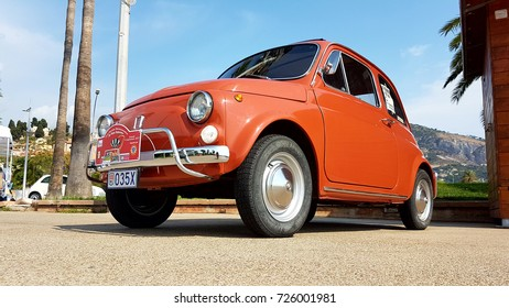 Menton, France - September 9, 2017: Old Red Fiat 500 L Parked on the Esplanade Francis Palmero in the City of Menton on the French Riviera