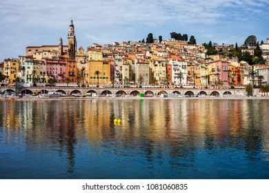Menton picturesque old town on French Riviera in France, water reflection in Mediterranean Sea
