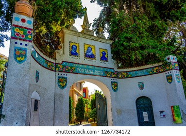 MENTON, PROVENCE-COTE D'AZUR, FRANCE - August 11, 2018: Facade adorned with colorful ceramics from the Giardino Fontana Rosa dedicated in 1921 by Vicente Blasco-Ibañez, to his favorite novelists.