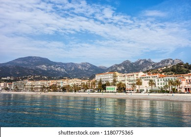 Menton resort town skyline from the sea in France, French Riviera coastline, Alpes-Maritimes, Provence-Alpes-Cote d'Azur region.