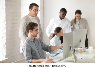 Mentor consulting intern explaining computer office task, team leader helping employee find online problem solution, executive manager teaching instructing new worker, corporate teamwork concept