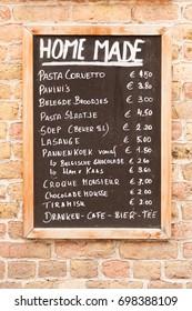 Menu board with local homemade food in Bruges, Belgium