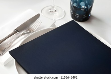 Menu card on a table set in a luxurious restaurant
