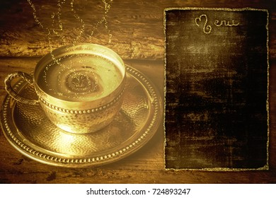 Menu Christmas background, vintage cup of coffee and old blackboard with copy space, shiny golden texture