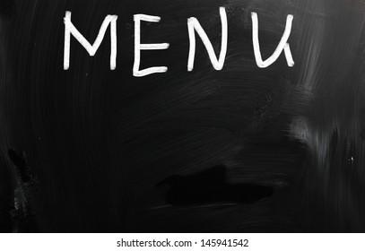 """Menu"" handwritten with white chalk on a blackboard"