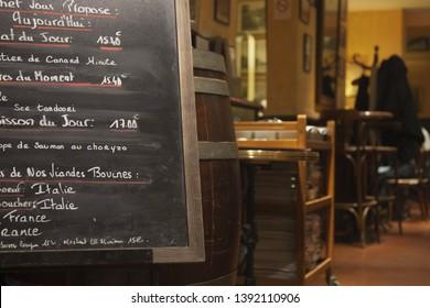 Menu on blackboard in a brasserie of Paris