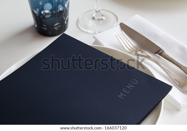 Menu on a table set in a restaurant