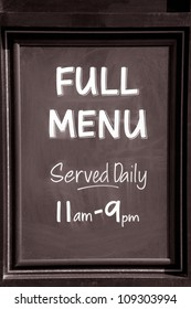 Menu sign serving food between 11am to 9pm