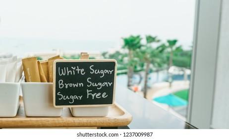 Menu of Sugar pack at coffee bar.