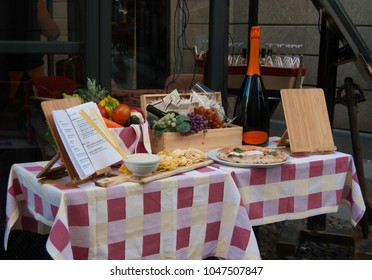 Menu with table set outside Italian restaurant - Milan