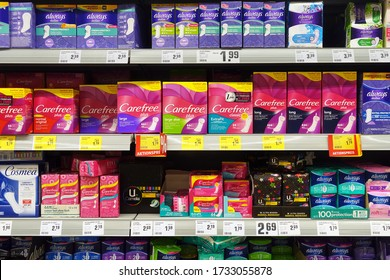 MEPPEN, GERMANY - AUGUST 21, 2018: Feminine hygiene products in a shop. Assortment different brand menstrual hygiene products in a REWE supermarket.