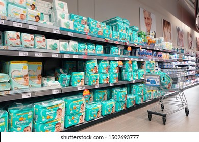 MEPPEN, GERMANY – AUGUST 9, 2019: Aisle with diapers in a German Marktkauf Hypermarket. Pampers is a brand of baby products marketed by Procter & Gamble.