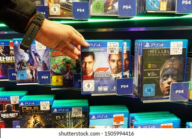 MEPPEN, GERMANY – AUGUST 9, 2019: Formula 1 race game in a store display filled with PlayStation 4 games for a home video game console.
