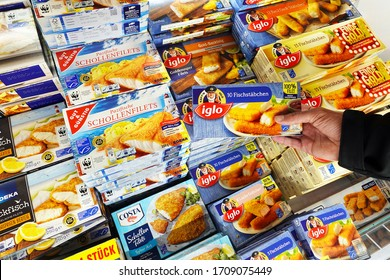 MEPPEN, GERMANY - AUGUST 9, 2019: Frozen Fishfingers in the frezer of a store. Processed seafood the frozen food section of a Marktkauf Hypermarket.