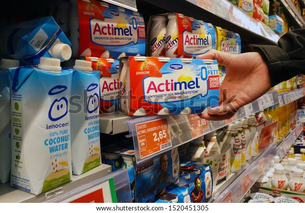 MEPPEN, GERMANY – AUGUST 9, 2019: Actimel probiotic yogurt in a Marktkauf Hypermarket. Actimel, also known as DanActive, is a 'probiotic' yogurt-type drink produced by the French company Danone.