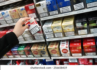 MEPPEN, GERMANY - FEBRUARY 27: Cigarette packages with the warning: smoking is lethal, in a Kaufland supermarket cigarette counter in Meppen, Germany on February 27, 2015