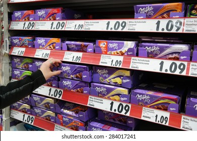MEPPEN, GERMANY - FEBRUARY 27: Shelves with a variety of Milka chocolate bars in a Kaufland supermarket. Milka is a Swiss brand of chocolate confection. Taken on February 27, 2015 in Meppen Germany