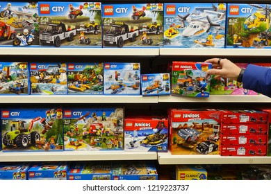 MEPPEN, GERMANY - OCTOBER 30, 2018: Shelves shows assortment Lego City boxes in a Toy store. LEGO is a popular line of construction toys manufactured by The Lego Group.
