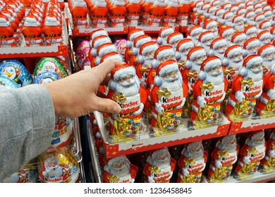 MEPPEN, GERMANY - OCTOBER 30, 2018: Store with stack of chocolate Santa Clauses from Kinder brand, a confectionery product brand line of Italian confectionery multinational Ferrero SpA.