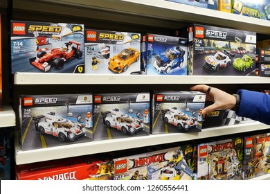 MEPPEN, GERMANY - OCTOBER 30, 2018: Shelves shows assortment Lego Speed Champions boxes in a Toy store. LEGO is a popular line of construction toys manufactured by The Lego Group.