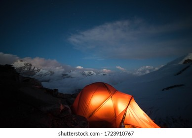 Mera Peak, mountains base camp with snow in Chaurikharka night in tent