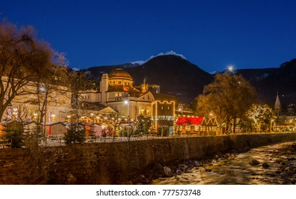 Meran Merano in South Tyrol, Italy, during the Christmas with christmans market by night . Beautiful light and great atmosphere