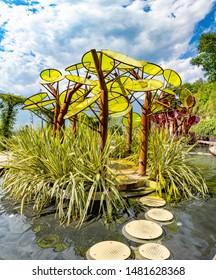 Meran, Province Bolzano/Italy - August 5, 2019: garden of love with scenic art and lake located in, Die Gaerten von Schloss Trauttmansdorff, South Tyrol, Italy.