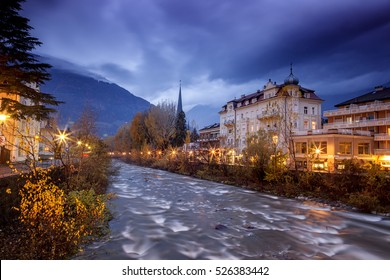 Merano, a beautiful town in the Alpine mountains of South Tyrol. A view of the night city and the river.