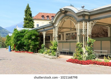 Merano, Italy - August 3, 2017: Wandelhalle building with bench in Merano, South Tyrol. The Wandelhalle was originally erected in the 1860s, to provide sheltered seating for visitors.