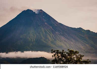 Merapi volcano crater view with lava dome and pyroclastic flow cliff path view from Cangkringan village, Yogyakarta