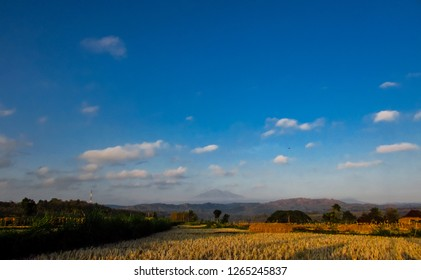 Merbabu Mount under blue sky and white clouds, Indonesia