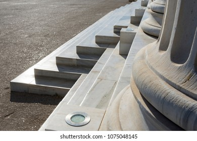 merble stairs and columns in entrance of zapio building in athens