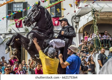 MERCADAL, MINORCA. AUGUST 19th, 2013: traditional jaleo festival. the Jaleo consists of making horses dance among the crowd while an orchestra plays the same song over and over again.