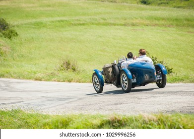 Mercatino Conca, Italy - 2017, may: vintage car on winding road