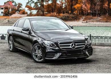 Mercedes Benz E200 W213 in a black color under the bridge. Krasnodar, Russia - October 2019.