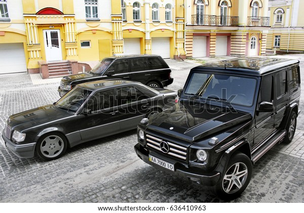 Mercedes E500 W124 Wolf Mercedes G55 Stock Photo (Edit Now