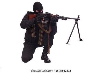 mercenary in black uniform with machine gun and ammunition belt isolated on white background