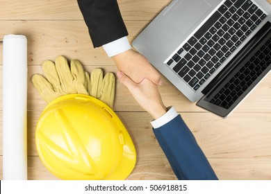 The merchant and the engineering contractor shook hands
