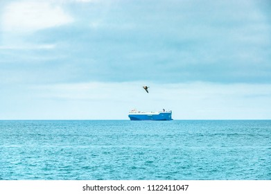 Merchant ship leaving port to the high seas, in the Cantabrian sea, off the coast of Cantabria, Spain