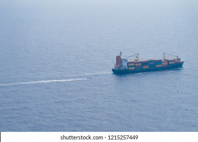 merchant vessel at sea with containers, big cargo ship doing exportation