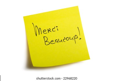 Merci Beaucoup! Sticky note. Isolated on white background with clipping path.