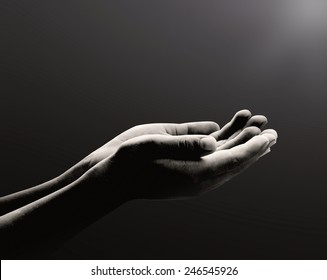 Mercy concept: Black and white humble man open two empty hands with palms up