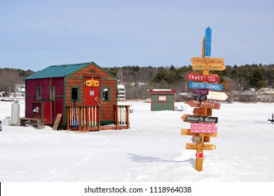 Meredith, NH, USA March 3, 2015 Signs point the way to a multitude of ice fishing shacks on a frozen Lake Winnipesaukee in Meredith, New Hampshire