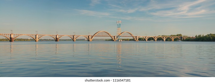 """Merefa-Kherson"" railway bridge across the  Dnieper River in Dnepropetrovsk (Ukraine), urban landscape"